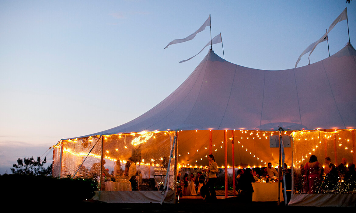Sailcloth Wedding Tent Rental at Dusk
