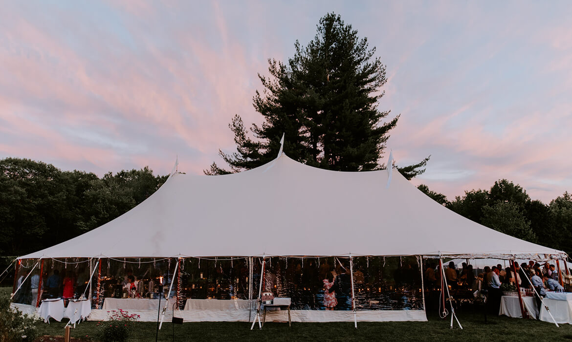 Sailcloth Wedding Tent Rental with Beautiful Sky