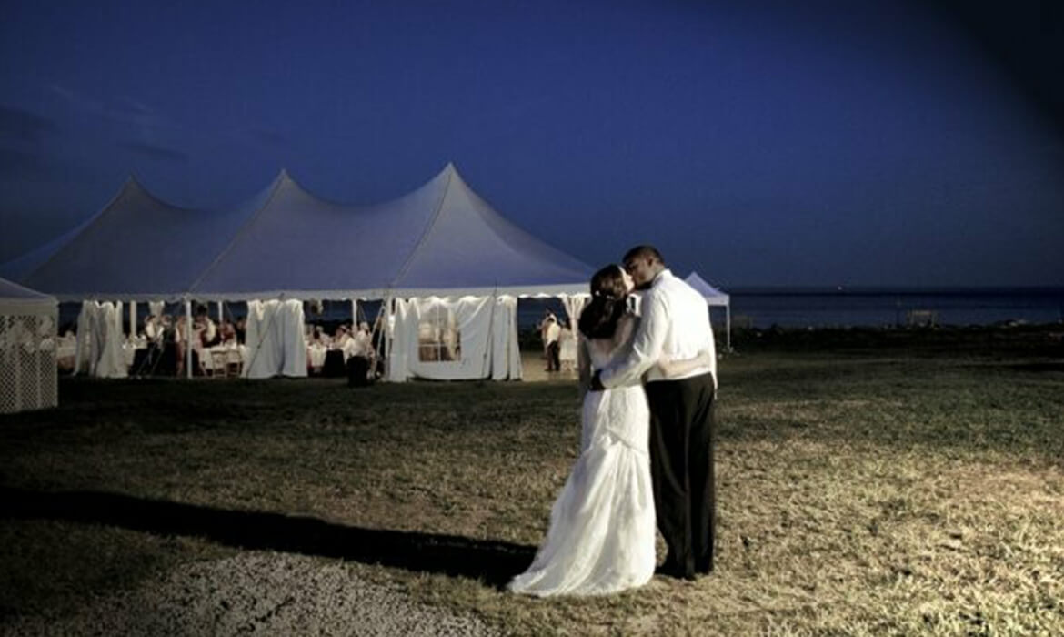 Happy Couple Outside Tension Wedding Tent Rental