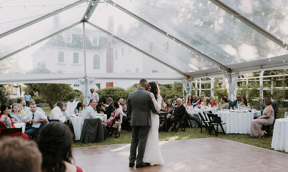 Dancing under the Clear Frame wedding tent